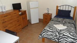 A bed or beds in a room at Star Inn Accommodation