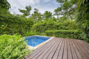 The swimming pool at or near The Village Coconut Island Beach Resort - SHA Plus
