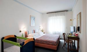 A bed or beds in a room at Hotel San Marco