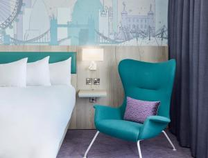 A bed or beds in a room at Jurys Inn London Croydon