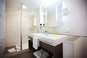 Ванная комната в Hotel Hirsch