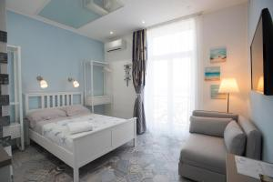 A bed or beds in a room at Nereidi Suites