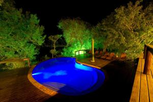 The swimming pool at or near Elephant Plains Game Lodge