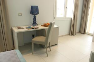 A television and/or entertainment center at 103 Boutique Hotel Stintino