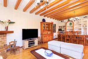 A television and/or entertainment center at Home2Book Luxury Villa Luna de Tacoronte Pool