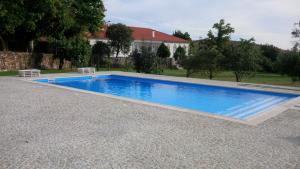 The swimming pool at or near Solar de Almeidinha