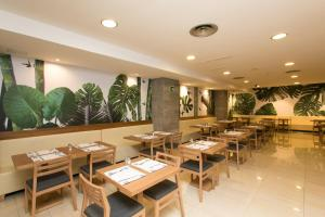 A restaurant or other place to eat at Hotel Don Pepe - Adults Only