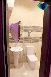 Um banheiro em Tafasel Aparthotel
