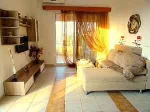 A bed or beds in a room at Cozy apartment in Paradisi