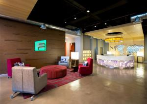 The lobby or reception area at Aloft Cancun