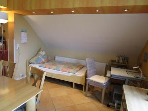 A bed or beds in a room at Pension Kölzer