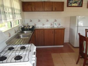 A kitchen or kitchenette at Green Lodge Holiday Homes