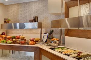 A kitchen or kitchenette at The Reef Eilat Hotel by Herbert Samuel