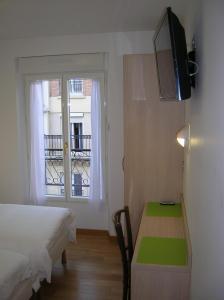 Letto o letti in una camera di Hotel Darcet
