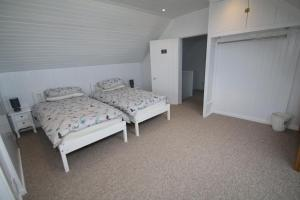 A bed or beds in a room at Arle Farmhouse