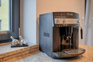 Coffee and tea making facilities at APARTAMENT LIPOWA