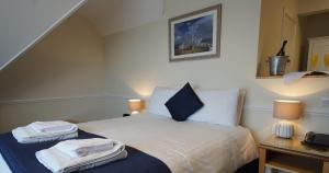 A bed or beds in a room at Grand Hotel Swanage