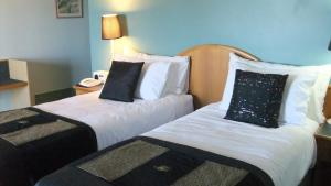 A bed or beds in a room at Heritage Resort Shark Bay