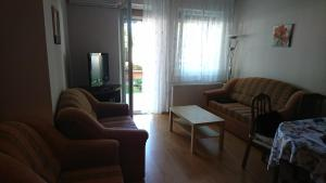 A seating area at Villa Palazzo Apartments