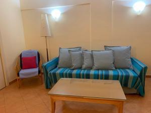 A seating area at Cabanas de Tavira Apartment