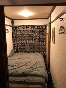 A bed or beds in a room at Shabby House