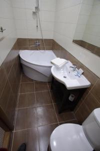 Ванная комната в Carlson Hotel Zheleznogorsк