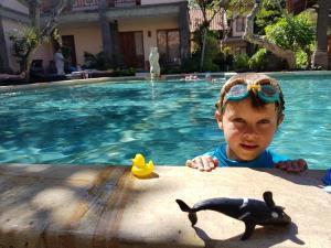 The swimming pool at or close to Puri Mesari Hotel