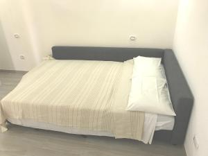 A bed or beds in a room at Good Vibe Sardinia B&B