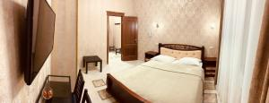 A bed or beds in a room at Hotel Day and Night on Michurinskiy