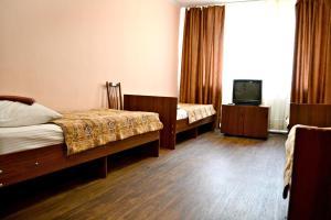 Кровать или кровати в номере Гостиница Колос