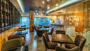 El salón o zona de bar de Sweet Home Boutique Hotel