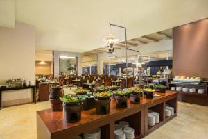 A restaurant or other place to eat at Hotel Santika Taman Mini Indonesia Indah