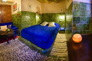 A bed or beds in a room at Kasbah Dar Daif