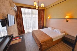 """Кровать или кровати в номере ЖД """"Amvel"""""""