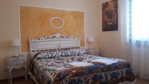Letto o letti in una camera di Villa Rosetta Suite vista mare