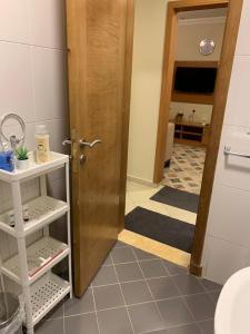 Um banheiro em Altelal Apartment