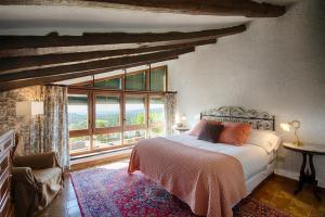 Cama o camas de una habitación en Masia Can Pou