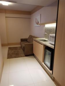 A cozinha ou cozinha compacta de Flat Premium - Luxo & Conforto
