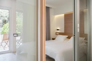 A bed or beds in a room at Forum Suites