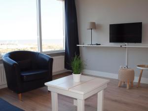 Een TV en/of entertainmentcenter bij Residence Le Mistral