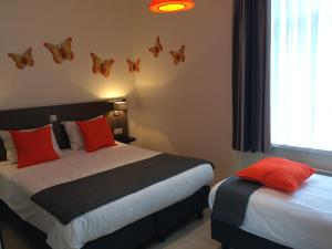 A bed or beds in a room at B&B Geste d' Alice