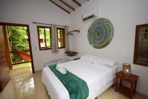 Cama ou camas em um quarto em Quintessência Pousada de Charme