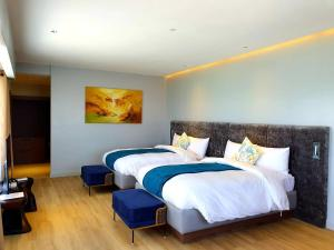A bed or beds in a room at Pinnacle Boracay