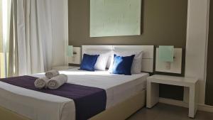 Cama ou camas em um quarto em Ravenala Hotel Boutique