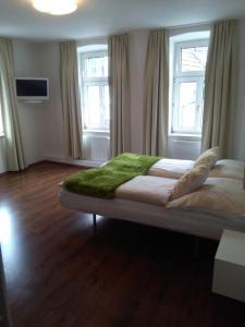 A bed or beds in a room at Gasthof zur Venus