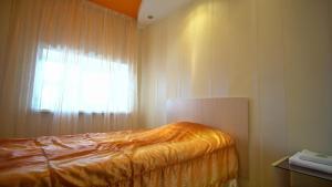 Кровать или кровати в номере Апартаменты Квартал на Гагарина 2