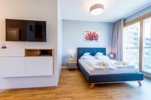 Ein Bett oder Betten in einem Zimmer der Unterkunft GO Apartments