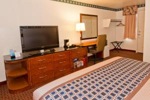 A television and/or entertainment center at Riviera Inn