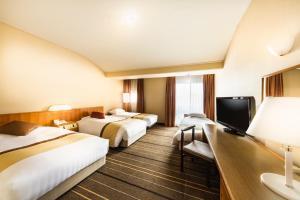 A television and/or entertainment center at Senri Hankyu Hotel Osaka