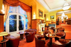 The lounge or bar area at Grand hotel Starý Smokovec
